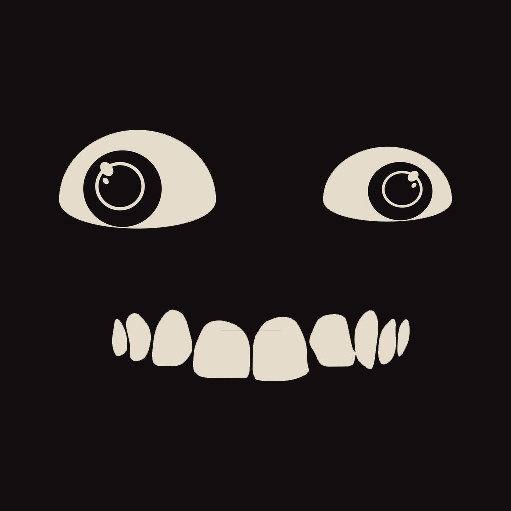 Black background with monster eyes and crooked teeths smile.